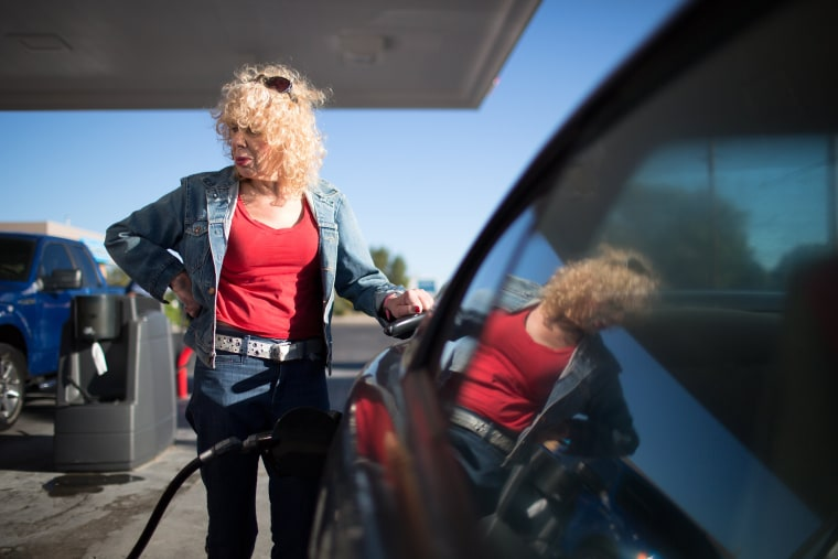 Denee Mallon pumps gas into her Ford Mustang in Albuquerque, N.M. Mallon is an Army veteran and transgender woman and is about to be the first person to have Medicare pay for her male to female sex reassignment surgery, Oct. 1, 2014. (Jim Seida/NBC News)
