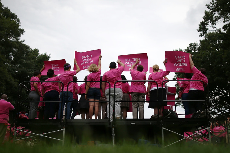 People hold up signs during a women's pro-choice rally on Capitol Hill on July 11, 2013 in Washington, DC. (Mark Wilson/Getty)