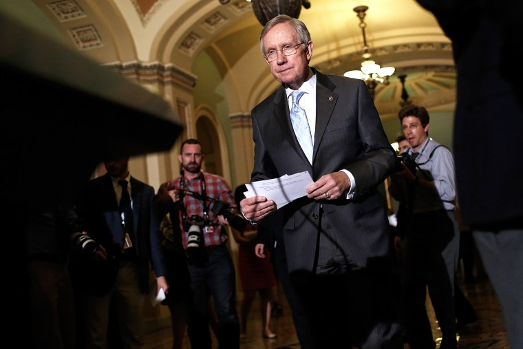 Senate Majority Leader Harry Reid (D-NV) arrives at a press conference on July 15, 2014 at the U.S. Capitol in Washington, D.C. (Photo by Win McNamee/Getty)
