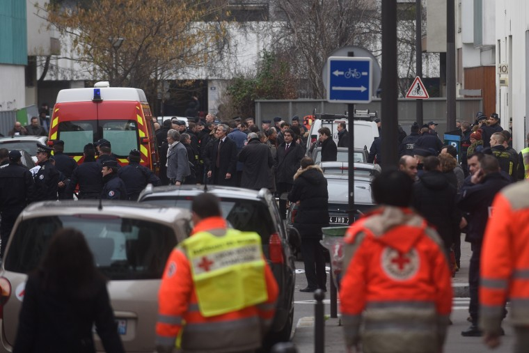 Ambulances and police officers gather in front of the offices of the French satirical newspaper Charlie Hebdo on Jan. 7, 2015 in Paris, France.