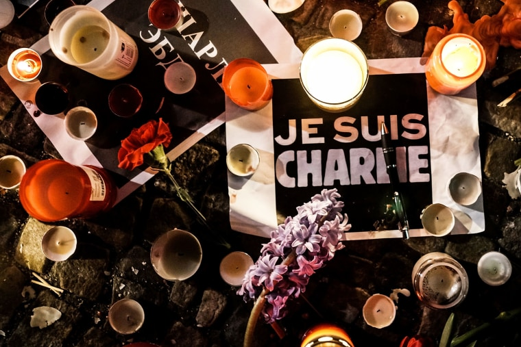 Papers with 'I am Charlie' displayed are left near candles at a vigil in front of the French Embassy following the terrorist attack in Paris on January 7, 2015 in Berlin, Germany. (Photo by Carsten Koall/Getty)