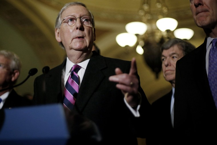 U.S. Senate Majority Leader Mitch McConnell (R-KY) calls on a reporter at a news conference after Democratic and Republican party policy luncheons at the U.S. Capitol in Washington on Jan. 7, 2015.