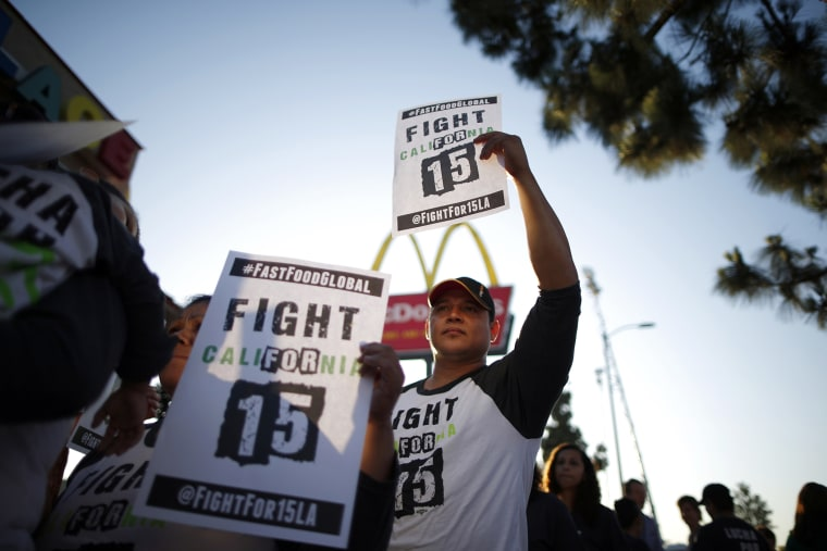 Demonstrators take part in a protest to demand higher wages for fast-food workers outside McDonald's in Los Angeles, Calif., on May 15, 2014. (Photo by Lucy Nicholson/Reuters)