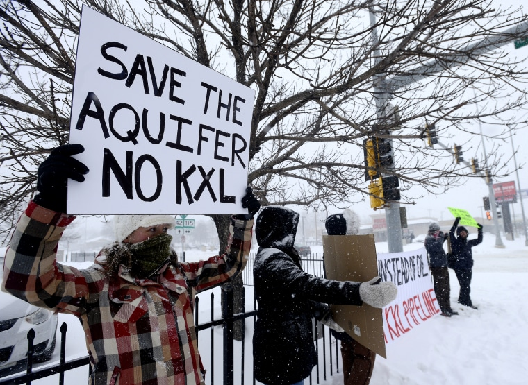 Valerie Schonewill and several others protest the proposed Keystone XL pipeline, Jan. 5, 2015, in Sioux Falls, S.D. (AP Photo/Argus Leader, Elisha Page)