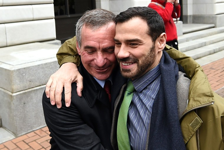 Louisiana plaintiffs, Havard Scott, left, and Sergio March embrace outside of the 5th U.S. Circuit Court of Appeals, Jan. 9, 2015, in New Orleans, La. (Photo by Stacy Revere/AP)