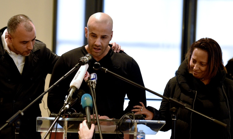Malek Merabet (C), brother of slain policeman Ahmed Merabet, during a press conference in Livry-Gargan, a Paris suburb, on Jan. 10, 2015 with Ahmed's brother-in-law Lotfi Mabrouk (L), and Ahmed's partner Morgane. (Photo by Martin Bureau/AFP/Getty)