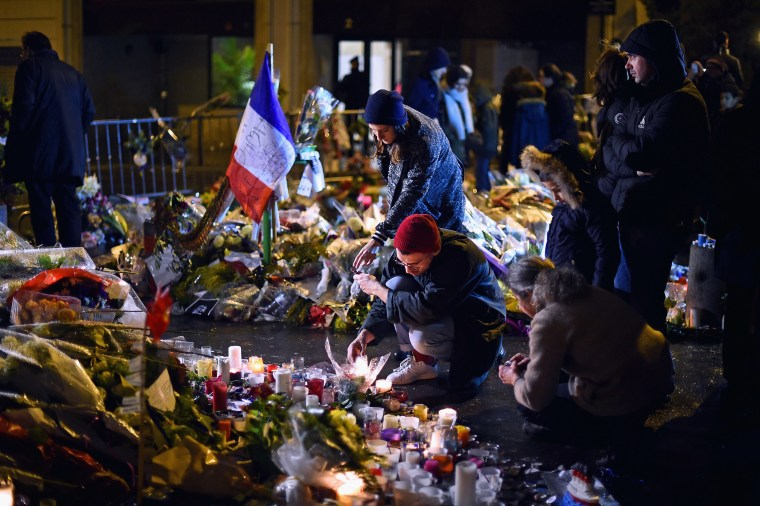 Members of the public light candles in tribute near the offices of French satirical magazine Charlie Hebdo on Jan. 10, 2015 in Paris, France. (Photo by Jeff J Mitchell/Getty)
