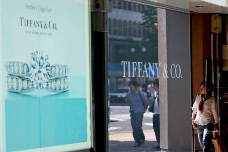 A pedestrian walks past a Tiffany & Co. advertisement in Sapporo, Hokkaido Prefecture, Japan, on June 9, 2013.