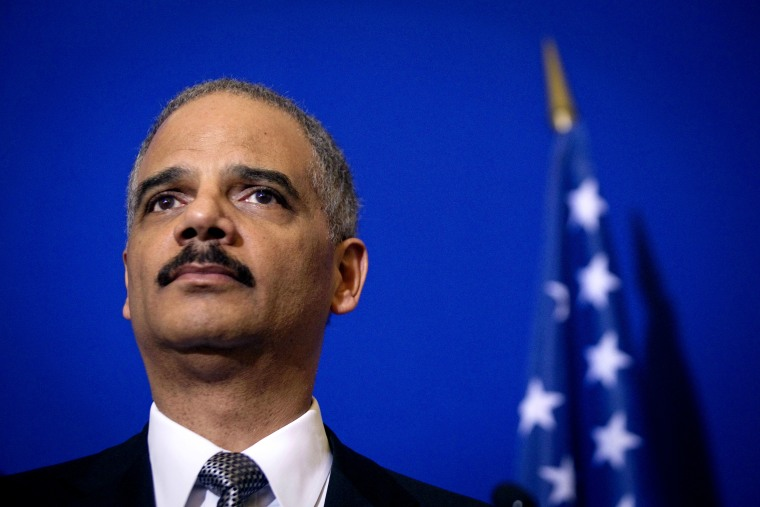 US General Attorney Eric Holder listens during a press conference following a meeting on May 9, 2011 at the Interior ministry Place Beauvau in Paris.