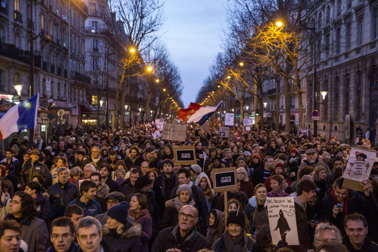 Demonstrators make their way along Place de la Republique during a mass unity rally following the recent terrorist attacks on Jan. 11, 2015 in Paris, France.