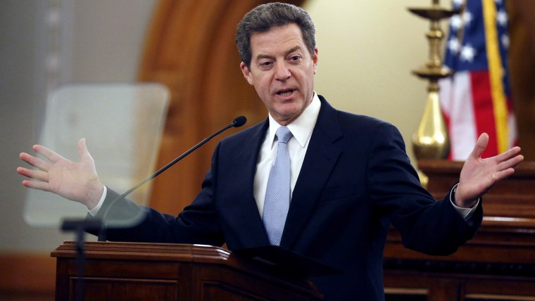 Kansas Gov. Sam Brownback delivers his State of the State speech to an annual joint session of the House and Senate at the Statehouse in Topeka, Kan., Wednesday, Jan. 15, 2014.  (Photo by Orlin Wagner/AP)