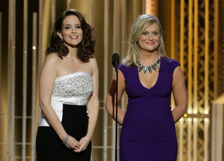 In this image released by NBC, co-hosts Tina Fey, left, and Amy Poehler speak during the 72nd Annual Golden Globe Awards on Jan. 11, 2015, at the Beverly Hilton Hotel in Beverly Hills, Calif.