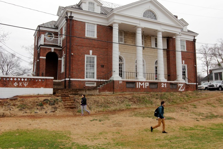 Students walk past the Phi Kappa Psi fraternity house on the University of Virginia campus on Dec. 6, 2014 in Charlottesville, Va.