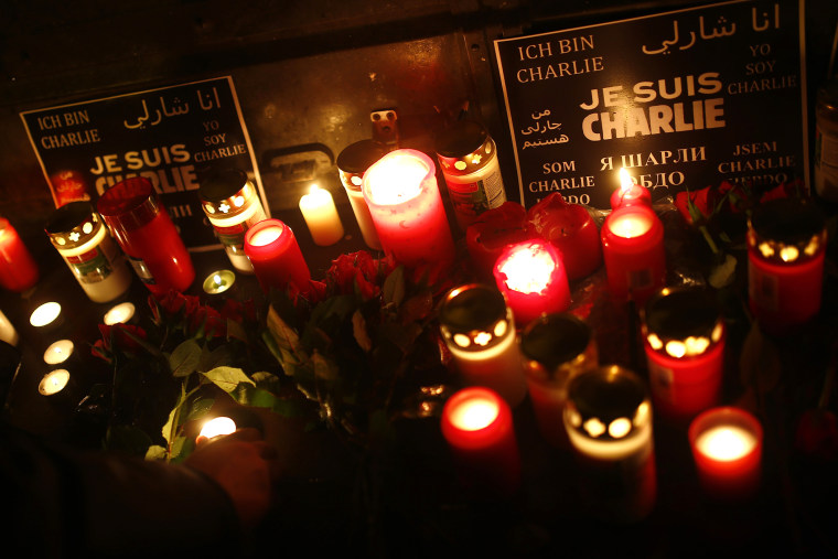 People light candles to pay tribute to victims during a vigil in Frankfurt on Jan. 8, 2015, following a shooting by gunmen at the offices of weekly satirical magazine Charlie Hebdo in Paris. (Photo Kai Pfaffenbach/Reuters)