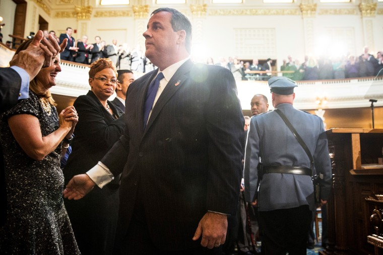 New Jersey Governor Chris Christie shakes hands with audience members before the annual State of the State address on Jan. 13, 2015 in Trenton, N.J. (Photo by Andrew Burton/Getty)