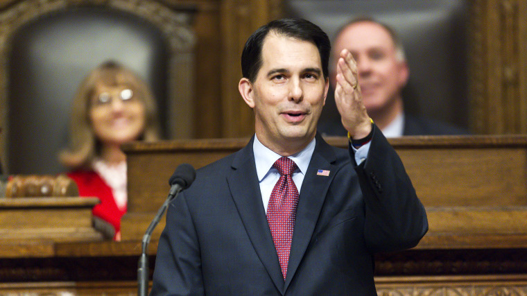 Wisconsin Gov. Scott Walker acknowledges people in the gallery during Governor's State of the State address to a joint session of the Legislature in the Assembly chambers at the state Capitol, Jan. 13, 2015, in Madison, Wis. (Photo by Andy Manis/AP)