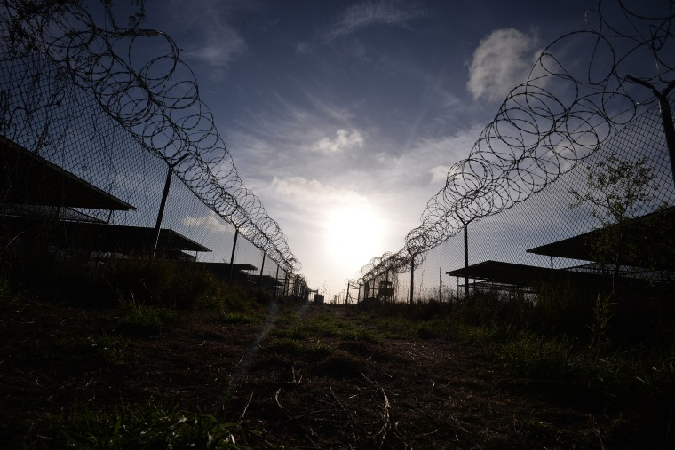 "This photo made during an escorted visit and reviewed by the US military, shows the razor wire-topped fence at the abandoned ""Camp X-Ray"" detention facility at the US Naval Station in Guantanamo Bay, Cuba April 9, 2014. (Photo by Mladen Antonov/AFP/Getty)"