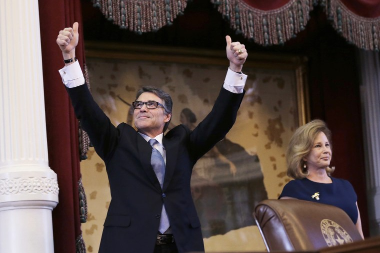 Texas Gov. Rick Perry, left, acknowledges applause next to his wife, Anita, before giving a farewell speech to a joint session of the Texas Legislature, Jan. 15, 2015, in Austin, Texas. (Photo by Eric Gay/AP)