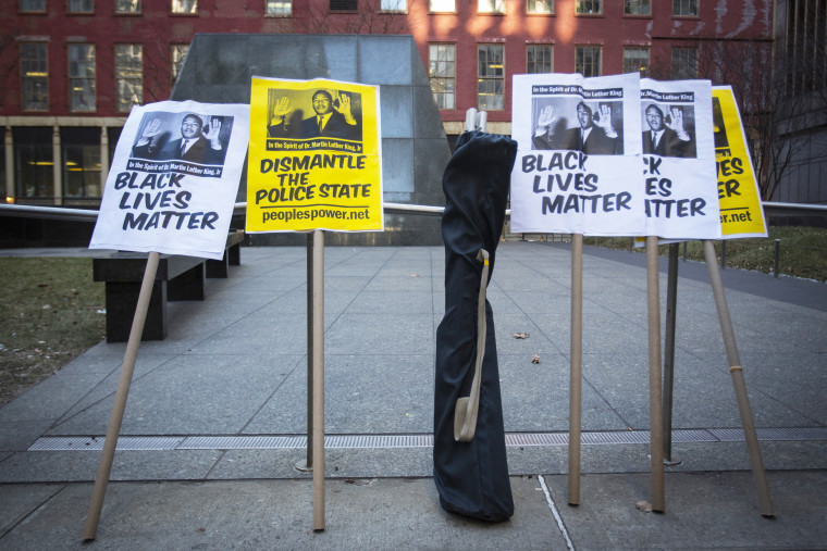 Signs are seen before a protest against police violence towards minorities in New York, N.Y. on Jan. 15, 2015. (Photo by Andrew Kelly/Reuters)