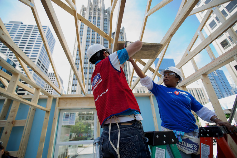 Volunteers erect a Habitat for Humanity home in Chicago, Ill., as part of an unprecedented building blitz in the heart of downtown Chicago. (Photo by Jeff Schear/Getty for Habitat For Humanity)