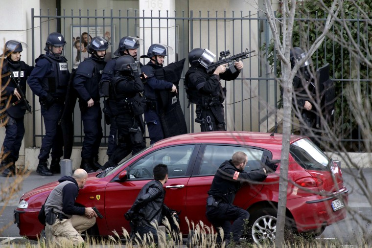French Research and Intervention Brigades (BRI) policemen officers near a post office where an armed man is holed up with two hostages, on Jan. 16, 2015 in Colombes, outside Paris. (Photo by Kenzo Tribouillard/AFP/Getty)