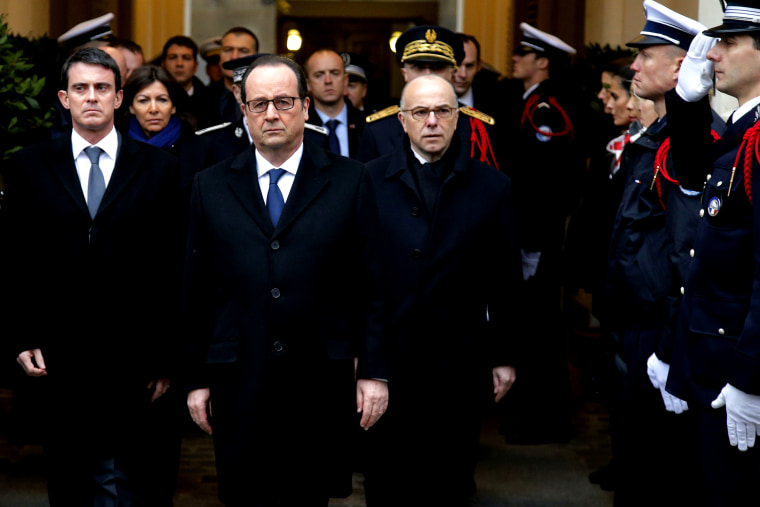 French President Francois Hollande (C), Prime Minister Manuel Valls (L) and Interior Minister Bernard Cazeneuve (R) pay tribute to the three police officers killed in the islamist attacks on Jan. 13, 2015 in Paris. (Photo by Francois Mori/AFP/Getty)