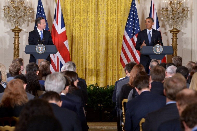 US President Barack Obama (R) and Britain's Prime Minister David Cameron hold a press conference in the East Room of the White House on Jan. 16, 2015, in Washington, DC. (Photo by Mandel Ngan/AFP/Getty)