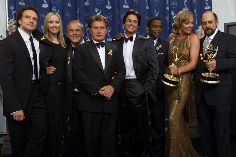"The cast of ""The West Wing"" pose for photographers at the 52nd Annual Primetime Emmy Awards in Los Angeles, Sept. 10, 2000. (Photo by Kevork Djansezian/AP)"