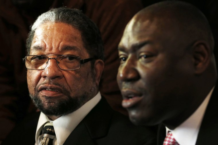 Howard Morgan (L) listens to his attorney Benjamin Crump at a news conference to discuss his release from prison in Chicago, Illinois, on Jan. 16, 2015. (Photo by Jim Young/Reuters)