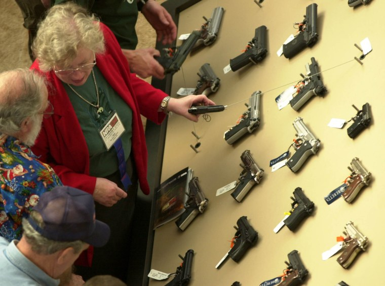 Visitors view a handgun display at the National Rifle Association convention Saturday, April 17, 2004, in Pittsburgh, Pennsylvania.