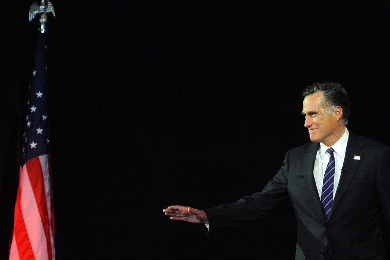Then, Republican presidential candidate Mitt Romney arrives on stage on Nov. 7, 2012 in Boston, Mass. (Photo by Emmanuel Dunand/AFP/Getty)