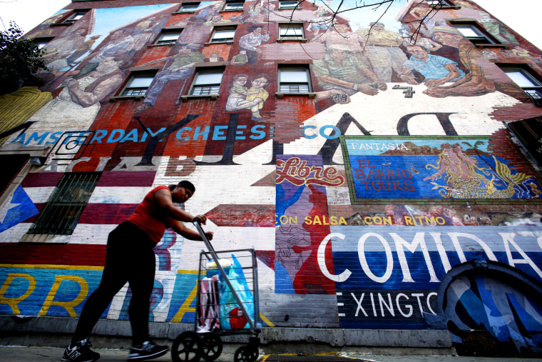 """""""The Spirit of East Harlem"""" mural in """"EL BARRIO,"""" Harlem, New York Aug. 10, 2014. A bubbling Hispanic cultural stew is brewing in New York, spiced by Latin American newcomers. (Photo by Eduardo Munoz/Reuters)"""
