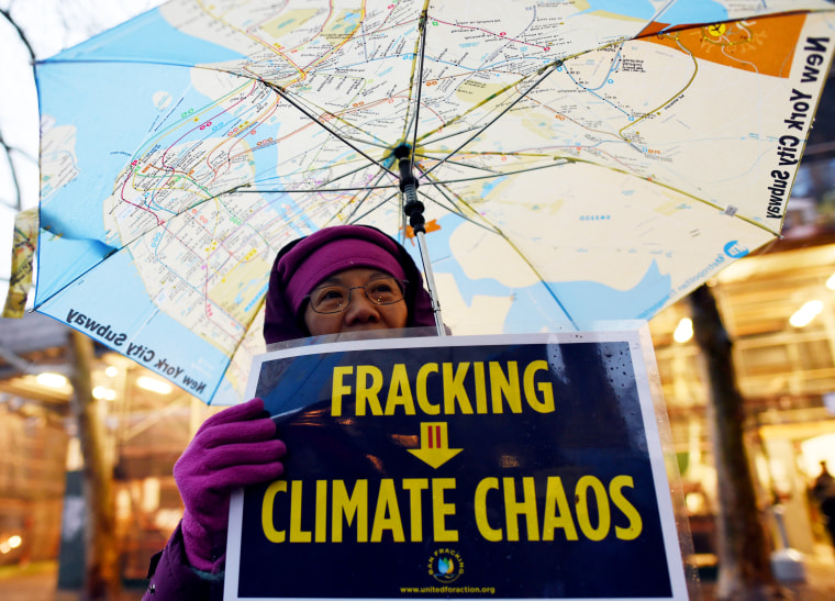 A woman holds an anti-fracking sign as a group of demonstrators gather for a rally for a Global Climate Treaty Dec. 10, 2014 near the United Nations in New York. (Photo by Don Emmert/AFP/Getty)
