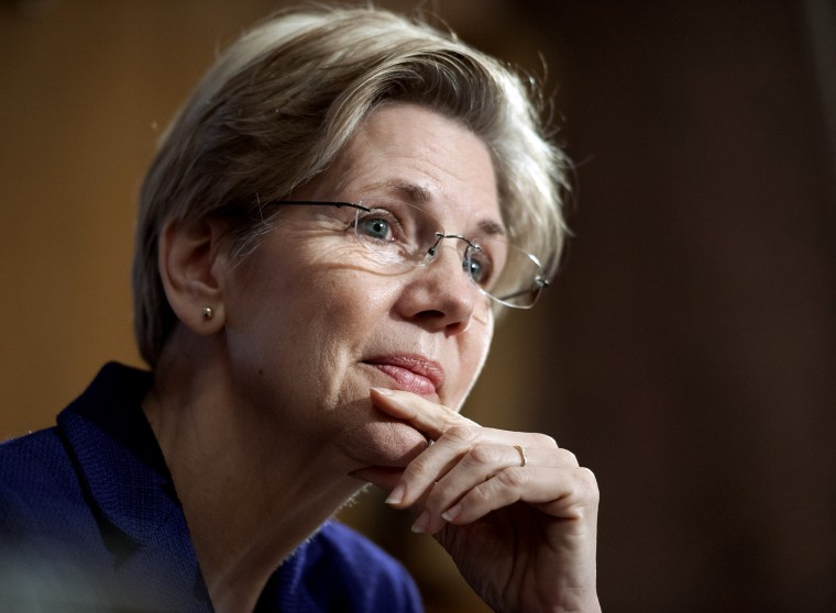 Sen. Elizabeth Warren, D-Mass., listens to a witness at Senate Banking Committee hearing on anti-money laundering on Capitol Hill in Washington on March 7, 2013. (Photo by Cliff Owen/AP)