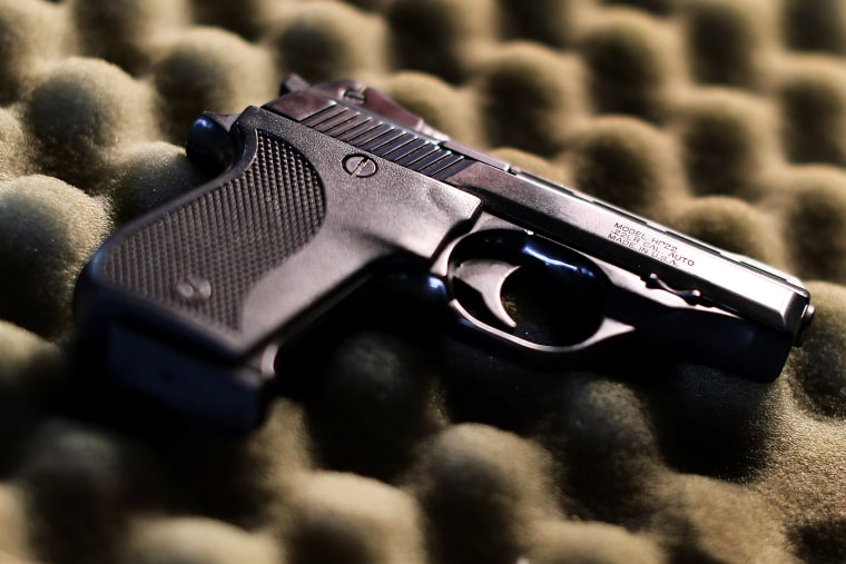 A detail view of a pistol. (Photo by Tom Pennington/Getty)