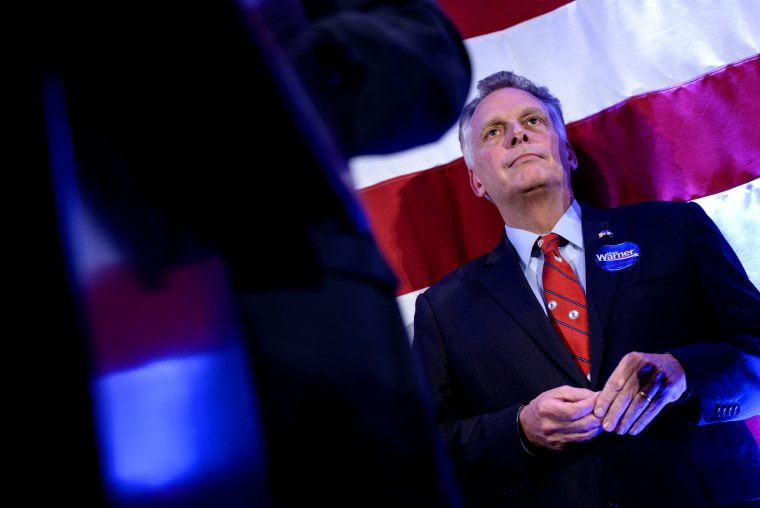 Virginia Governor Terry McAuliffe listens as midterm election results are announced during an election night rally Nov. 4, 2014 in Arlington, Virginia. (Photo by Brendan Smialowski /AFP/Getty)
