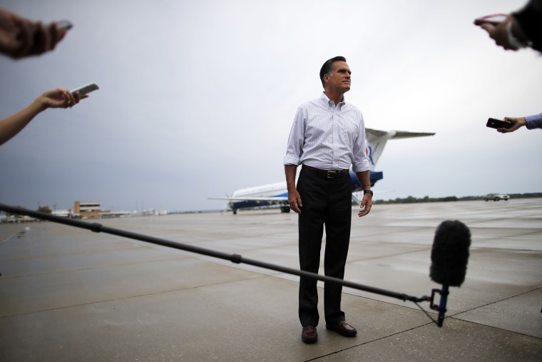 Then, Republican presidential candidate and former Massachusetts Governor Mitt Romney listens to a question from a reporter at the airport in Sergeant Bluff, Iowa on Sept. 7, 2012. (Photo by Brian Snyder/Reuters)