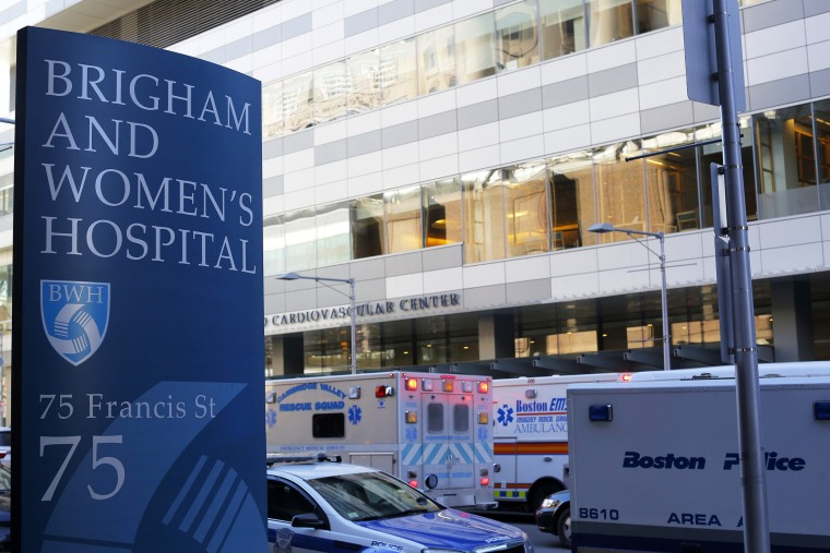 Police and ambulance vehicles surround the building where a shooting occurred at Brigham and Women's hospital in Boston, Mass. on Jan. 20, 2015. (Photo by Brian Snyder/Reuters)