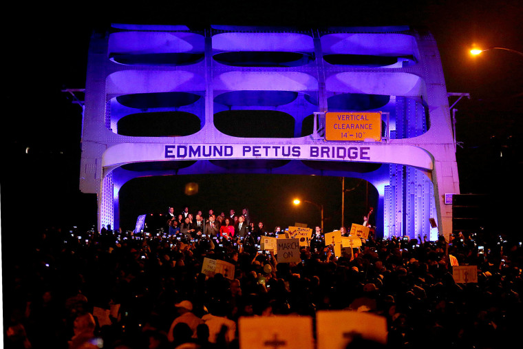 """Thousands march across the Edmund Pettus Bridge along with members of the cast of the movie """"Selma"""" in honor of Rev. Martin Luther King Jr. Day on Jan. 18, 2015 in Selma, Alabama. (Photo by Sean Gardner/Getty)"""