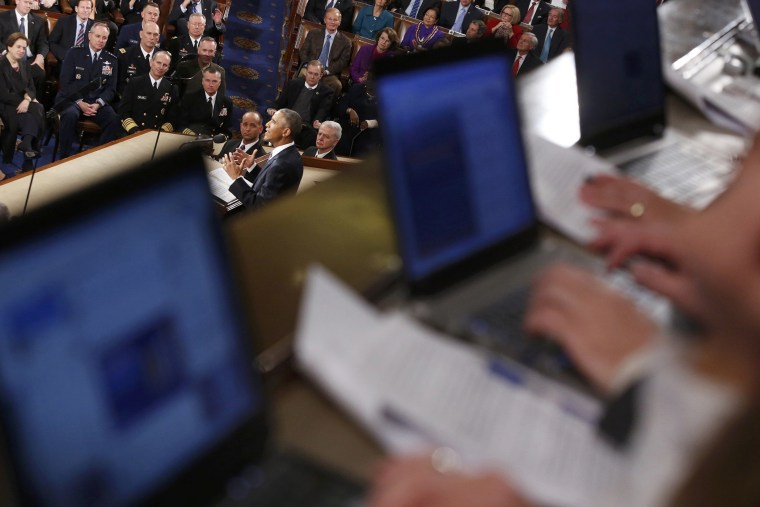Reporters write their stories on their computers in the gallery as U.S. President Barack Obama delivers his State of the Union address to a joint session of the U.S. Congress on Capitol Hill in Washington, Jan. 20, 2015. (Photo by Jonathan Ernst/Reuters)