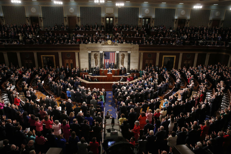 U.S. President Barack Obama (C) receives a standing ovation as he delivers his State of the Union address to a joint session of Congress in the U.S. Capitol in Washington, D.C., on Jan. 20, 2015. (Photo by Kevin Lamarque/Reuters)