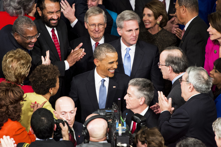 President Barack Obama greets members of Congress as he arrives in the House chamber in the U.S. Capitol to deliver his State of the Union address on Jan. 20, 2015. (Photo By Bill Clark/CQ Roll Call/AP)