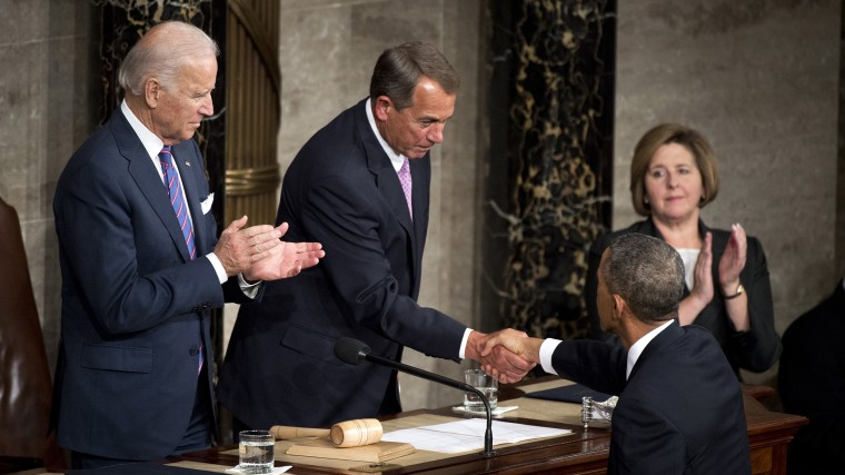 President Barack Obama greets Speaker John Boehner, R-Ohio, as Vice President Joe Biden looks on, in the Capitol's House chamber before Obama delivered his State of the Union address, Jan. 20, 2015. (Photo By Tom Williams/CQ Roll Call/Getty)