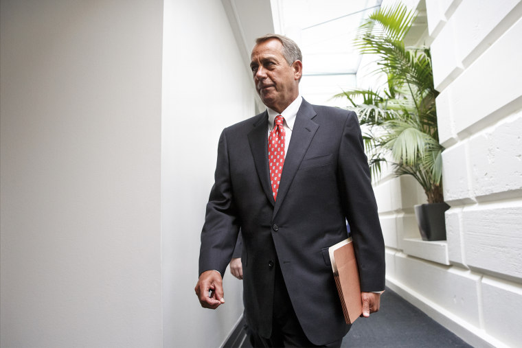 On the morning after President Barack Obama's State of the Union speech, House Speaker John Boehner of Ohio, arrives for a closed-door meeting with House Republicans, Jan. 21, 2015, on Capitol Hill in Washington. (Photo by J. Scott Applewhite/AP)