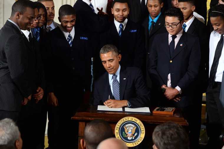 US President Barack Obama signs a presidential memorandum after speaking on his My Brothers Keeper initiative to expand opportunity for Americans in the East Room at the White House on Feb. 27, 2014 in Washington, D.C. (Photo by Jewel Samad/AFP/Getty)