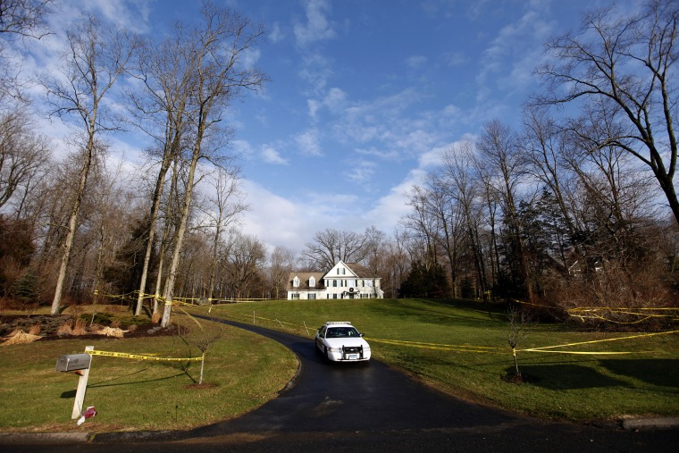 A police cruiser sits in the driveway as crime scene tape surrounds the home of Nancy Lanza, Dec. 18, 2012, in Newtown, Conn. (Photo by Jason DeCrow/AP)