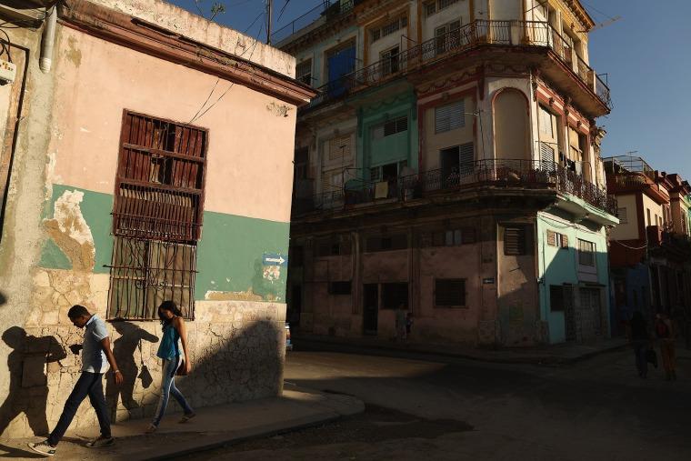 Young people walk through the Habana Central neighborhood on Jan. 21, 2015 in Havana, Cuba.