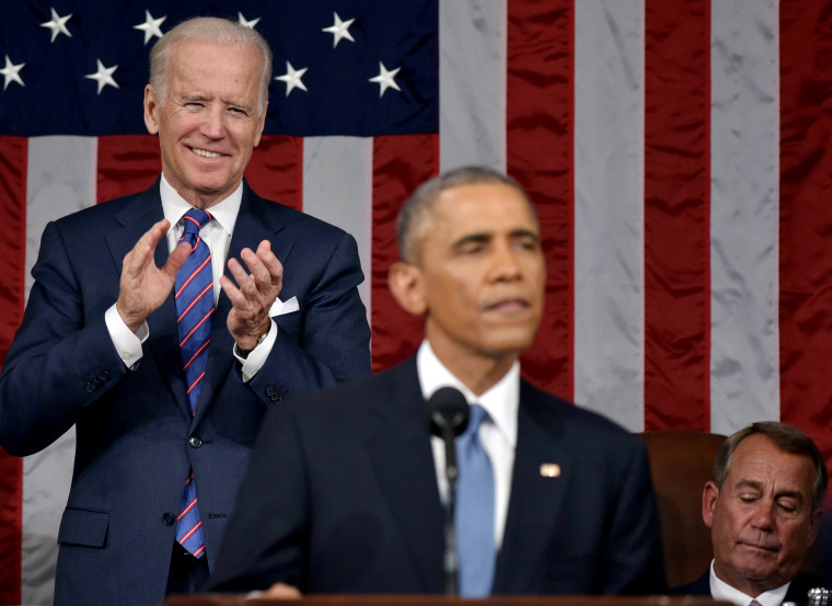 U.S. Vice President Joe Biden applauds President Barack Obama during the State of the Union address on Jan. 20, 2015 in the House Chamber of the U.S. Capitol in Washington, DC. (Photo by Mandel Ngan-Pool/Getty)