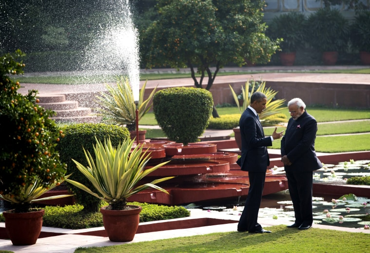 Indian Prime Minister Narendra Modi and US President Barack Obama talk in the gardens between meetings at Hyderabad House in New Delhi on Jan. 25, 2015. (Photo by Saul Loeb/AFP/Getty)