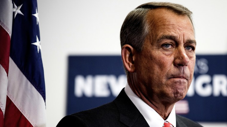 Speaker of the House John Boehner listens as his fellow Republicans speak to the media after a conference meeting with House Republicans on Capitol Hill in Washington Jan. 21, 2015. (Photo by Joshua Roberts/Reuters)